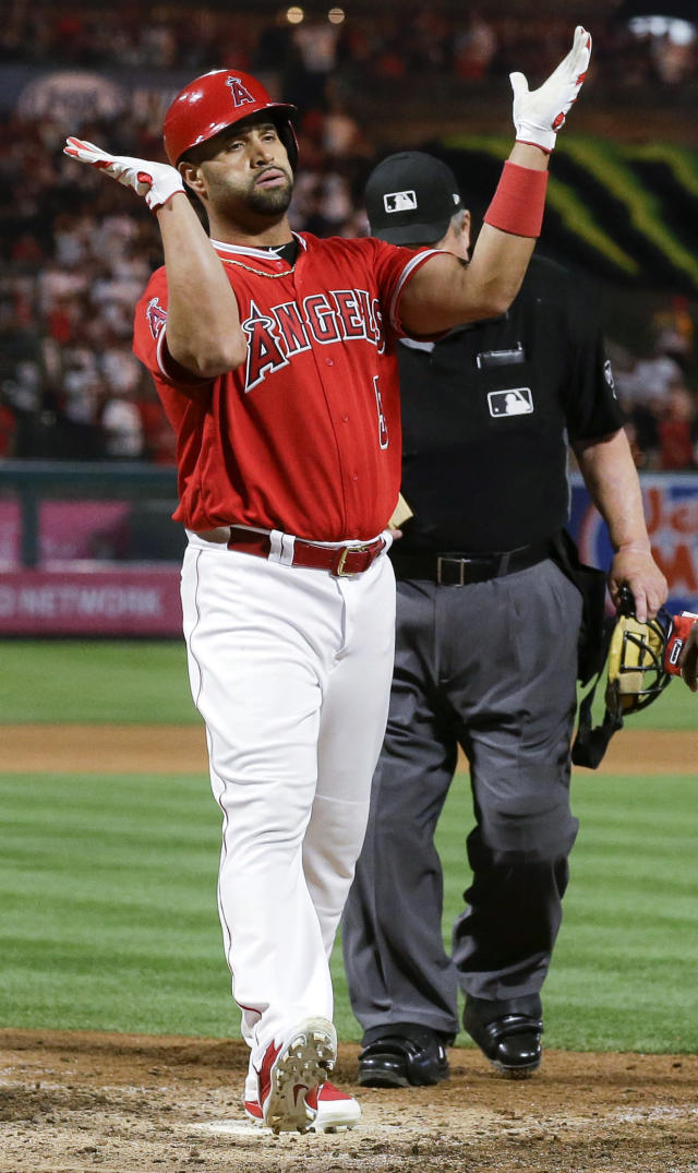 Los Angeles Angels' Albert Pujols celebrates after his two-run home run against the San Francisco Giants during the sixth inning of a baseball game in Anaheim, Calif., Saturday, April 21, 2018. (AP Photo/Chris Carlson)