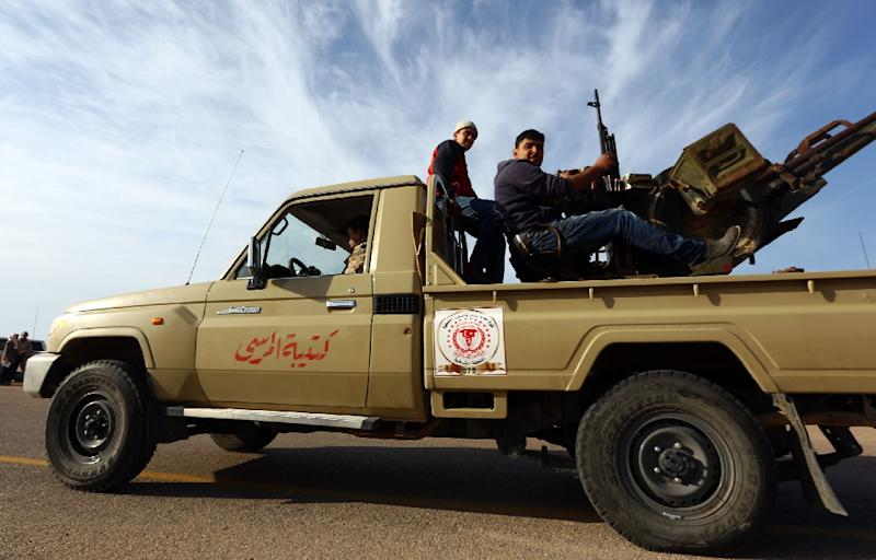 Members of a brigade loyal to the Fajr Libya sit on a truck mounted with a machine gun on March 15, 2015 in Libya's coastal city of Sirte (AFP Photo/Mahmud Turkia)