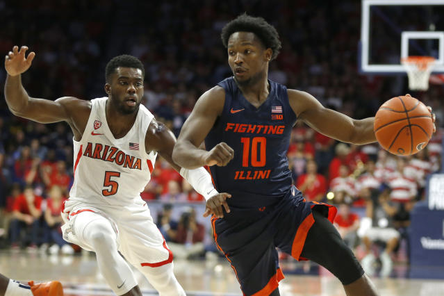 Illinois guard Andres Feliz (10) drives past Arizona guard Max Hazzard during the first half of an NCAA college basketball game Sunday, Nov. 10, 2019, in Tucson, Ariz. (AP Photo/Rick Scuteri)