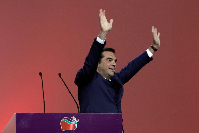 Greek PM Tsipras waves during a congress of leftist Syriza party in Athens