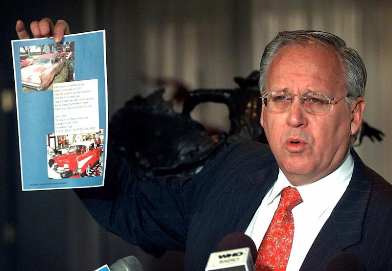 """FILE - In this March 16, 2009 file photo, Titan Tire Corporation President Maury Taylor shows a poster during a news conference, in Des Moines, Iowa. Maury has written a stinging letter to the French government, blasting the French work ethic saying workers waste time talking. The letter, which has ruffled French feathers and dominated media Wednesday, Feb, 20, 2013 since being published in """"Les Echos"""" newspaper, was written by Maurice Taylor to French Industrial Renewal Minister Arnaud Montebourg, to explain why Titan threw in the towel on purchasing an ailing Goodyear factory in Amiens France.  (AP Photo/Charlie Neibergall, File)"""