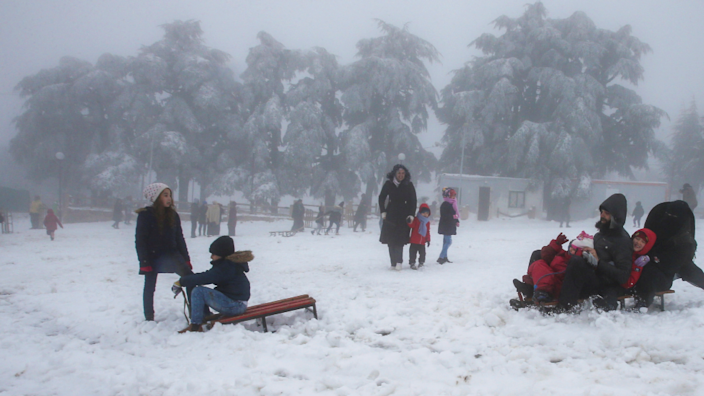 People play on snow sledges in the Chrea mountains in Blida, Algeria - Monday 22 March 2021