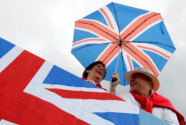 WINDSOR, ENGLAND - AUGUST 02: Team GB fans shelter from the rain under Union jack umbrellas on Day 6 of the London 2012 Olympic Games at Eton Dorney on August 2, 2012 in Windsor, England. (Photo by Jamie Squire/Getty Images)
