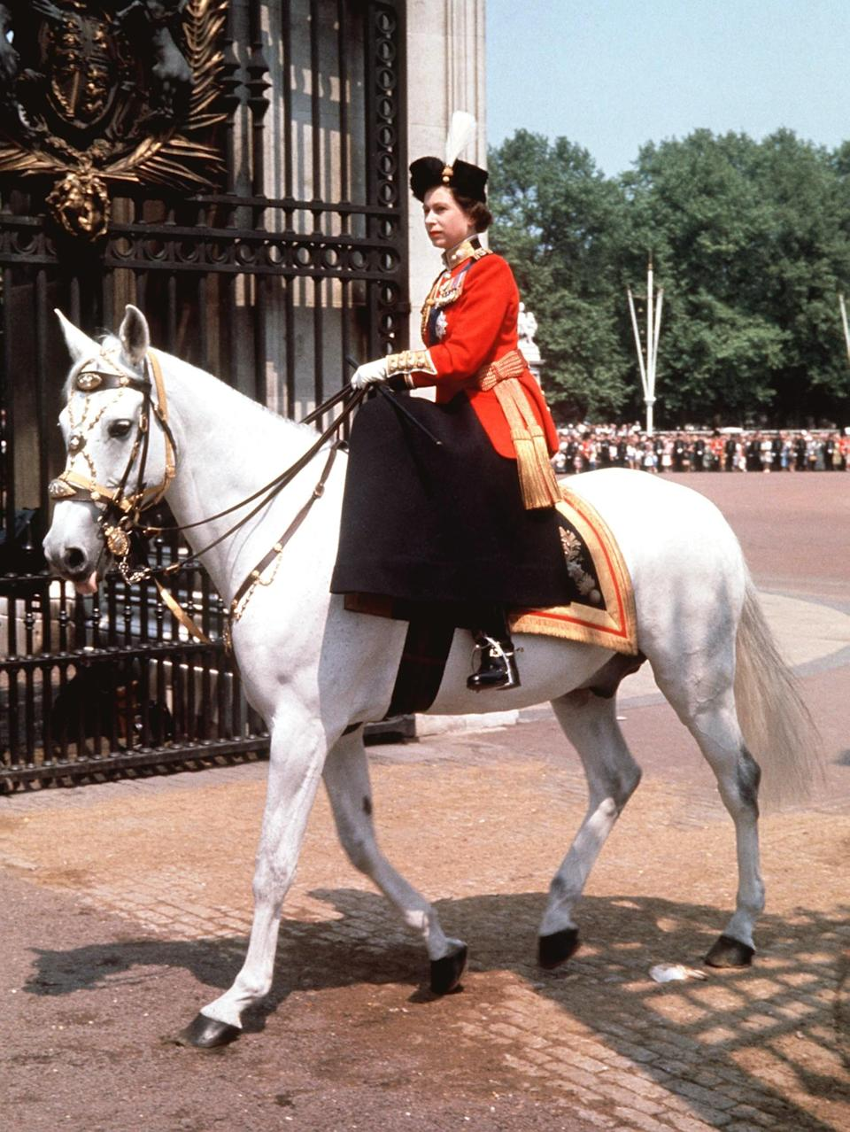 <p>The Queen returns to Buckingham Palace after attending the Trooping of the Colour ceremony. (PA Archive) </p>
