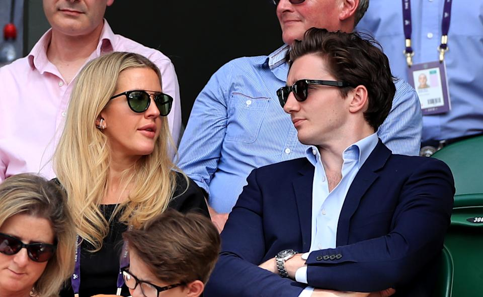 Ellie Goulding and Caspar Jopling watch the centre court action on day eight of the Wimbledon Championships at the All England Lawn Tennis and Croquet Club, Wimbledon.