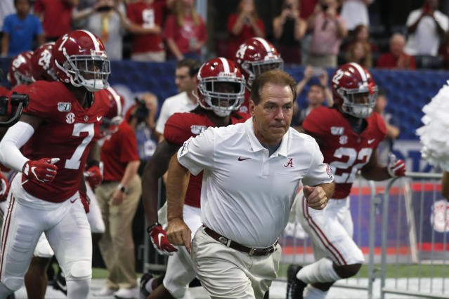 FILE - In this Aug. 31, 2019, file photo, Alabama head coach Nick Saban leads his team onto the field for a an NCAA college football game against Duke, in Atlanta. Around the country schools are taking the first cautious and detailed steps toward playing football through a pandemic, attempting to build COVID-19-free bubbles around their teams as players begin voluntary workouts throughout June. Thousands of athletes will be tested for COVID-19 _ though not all. (AP Photo/John Bazemore, File)