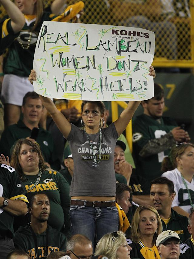 GREEN BAY, WI - SEPTEMBER 08: A fan of the Green Bay Packers holds a sign during the NFL opening season game against the New Orleans Saints at Lambeau Field on September 8, 2011 in Green Bay, Wisconsin. The Packers defeated the Saints 42-34. (Photo by Jonathan Daniel/Getty Images)