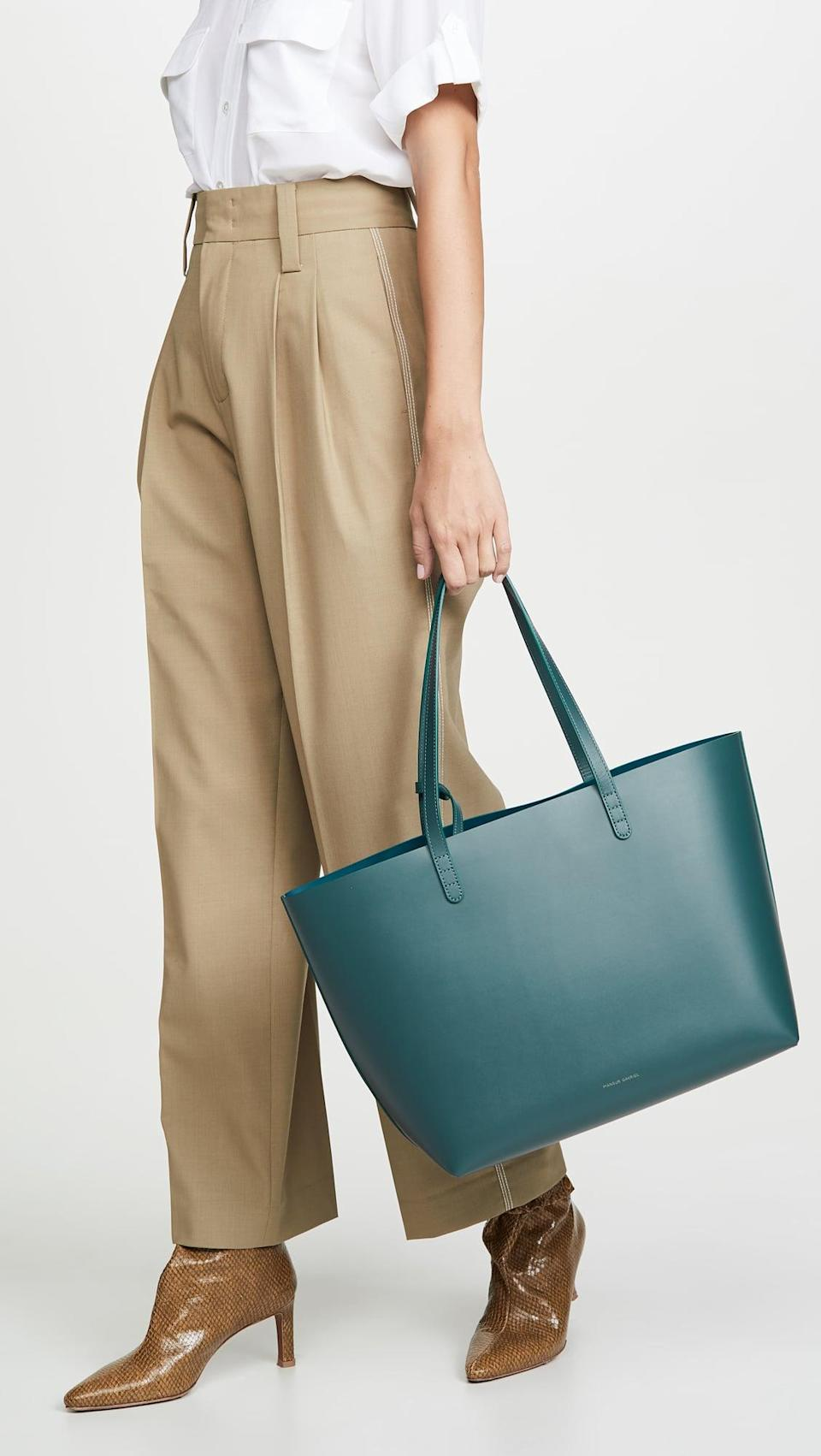 """<p>Spice up the basic tote silhouette with a fun color and get this <a href=""""https://www.popsugar.com/buy/Mansur-Gavriel-Large-Tote-551706?p_name=Mansur%20Gavriel%20Large%20Tote&retailer=shopbop.com&pid=551706&price=675&evar1=fab%3Aus&evar9=45623846&evar98=https%3A%2F%2Fwww.popsugar.com%2Ffashion%2Fphoto-gallery%2F45623846%2Fimage%2F47066457%2FMansur-Gavriel-Large-Tote&list1=shopping%2Caccessories%2Cbags%2Cworkwear&prop13=mobile&pdata=1"""" class=""""link rapid-noclick-resp"""" rel=""""nofollow noopener"""" target=""""_blank"""" data-ylk=""""slk:Mansur Gavriel Large Tote"""">Mansur Gavriel Large Tote</a> ($675).</p>"""