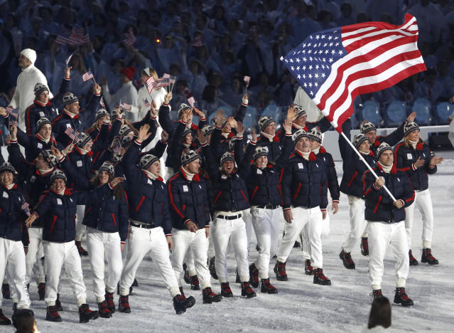 VANCOUVER, BC - FEBRUARY 12: Flag bearer Mark Grimmette of the United States leads his team through the stadium during the Opening Ceremony of the 2010 Vancouver Winter Olympics at BC Place on February 12, 2010 in Vancouver, Canada. (Photo by Jim Young-Pool/Getty Images)
