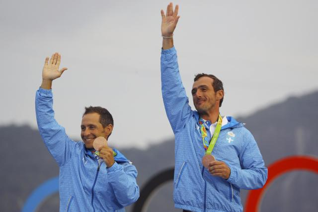 2016 Rio Olympics - Sailing - Victory Ceremony - Men's Two Person Dinghy - 470 - Victory Ceremony - Marina de Gloria - Rio de Janeiro, Brazil - 18/08/2016. Bronze medalists Panagiotis Mantis (GRE) of Greece and Pavlos Kagialis (GRE) of Greece pose with their medals. REUTERS/Brian Snyder FOR EDITORIAL USE ONLY. NOT FOR SALE FOR MARKETING OR ADVERTISING CAMPAIGNS.