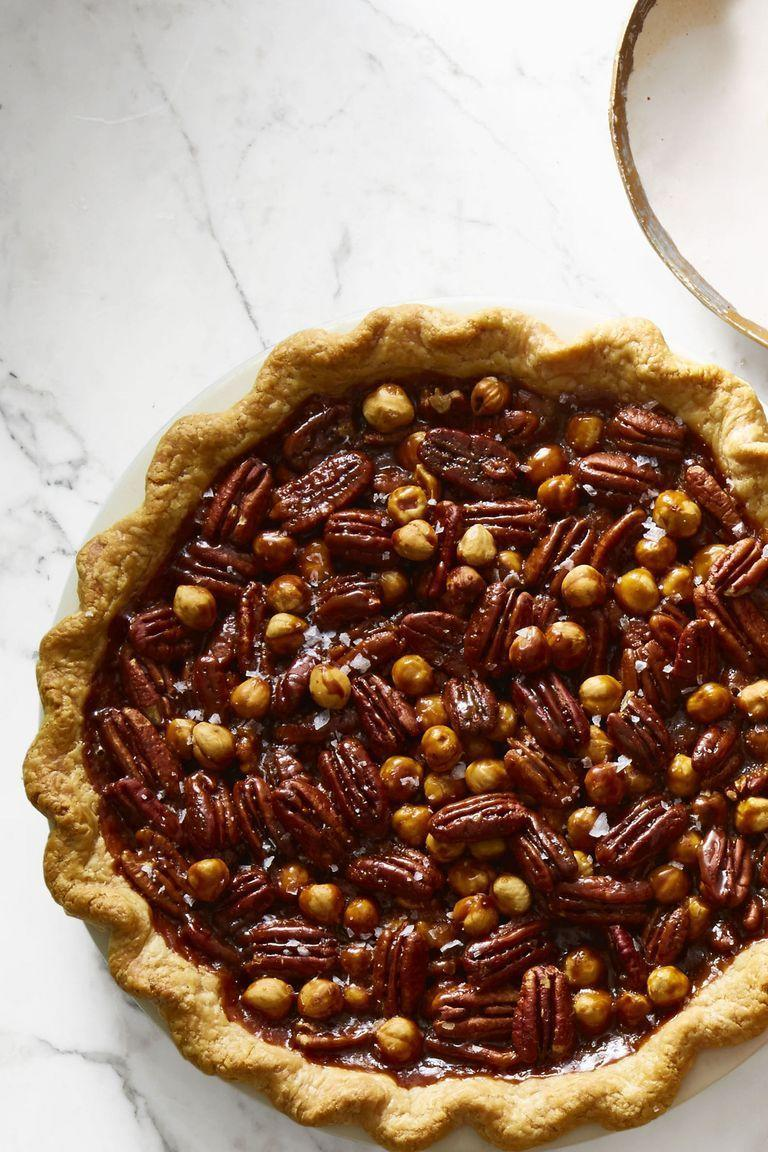 "<p>Your crowd will go nuts for these toasted pecans, walnuts, and hazelnuts held together by sweet caramel.</p><p><em><a href=""https://www.goodhousekeeping.com/food-recipes/a46628/salted-caramel-mixed-nut-pie-recipe/"" rel=""nofollow noopener"" target=""_blank"" data-ylk=""slk:Get the recipe for Salted Caramel Mixed Nut Pie»"" class=""link rapid-noclick-resp"">Get the recipe for Salted Caramel Mixed Nut Pie»</a></em> </p>"