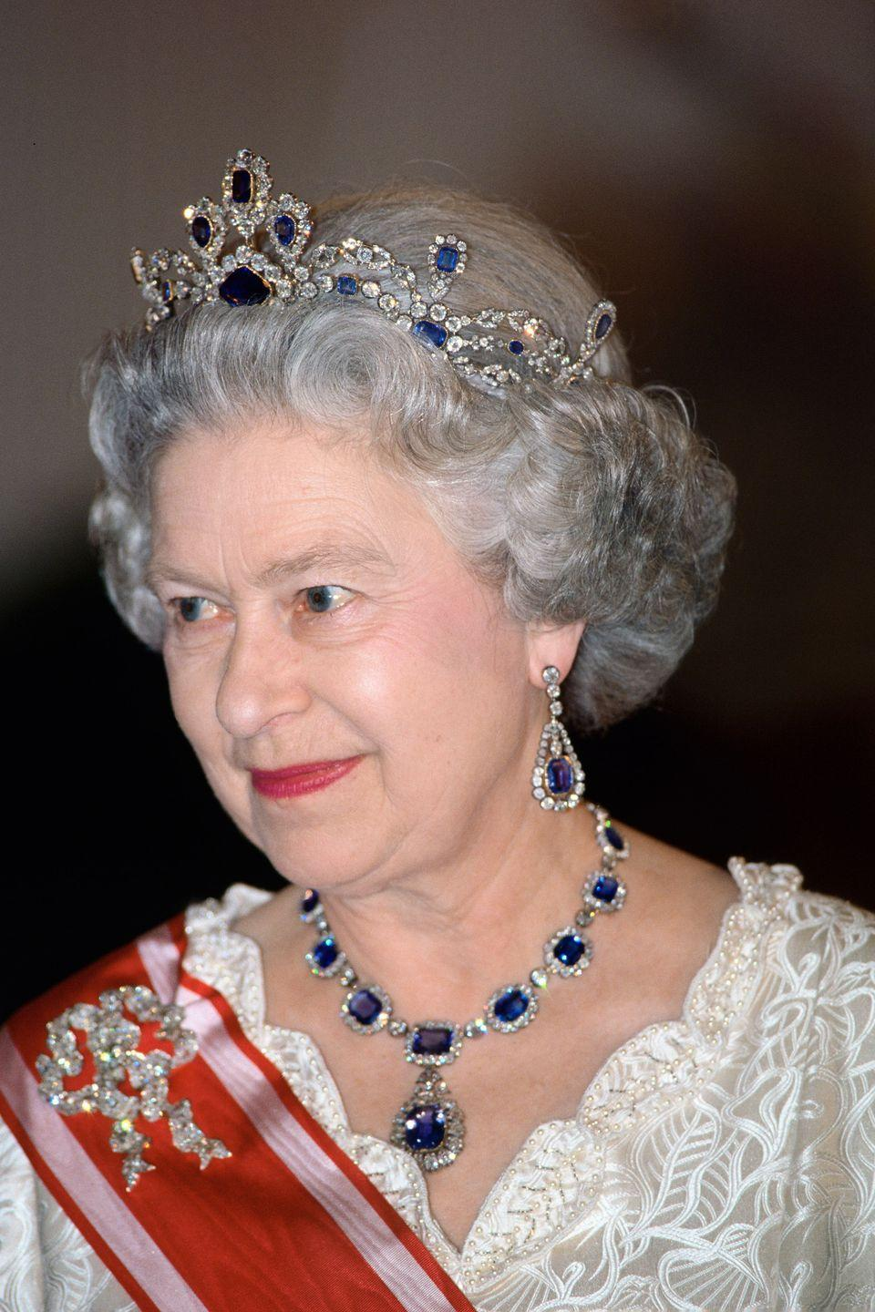 <p>The Queen's sapphire and diamond earrings and necklace were a wedding gift from her father, George VI, and date back to the Victorian era. The tiara is also from the same era and was purchased in 1963 to coordinate with the necklace and earrings. Its name comes from its original owner, Princess Louise of Belgium.</p>