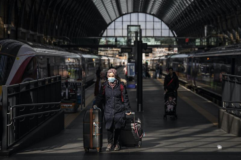 A passenger wears a protective mask at King's Cross train station on March 16, 2020 in London, England: Dan Kitwood/Getty Images