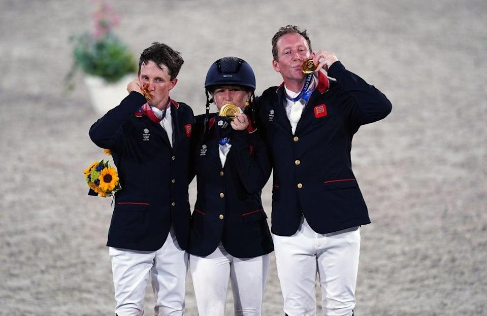 Tom McEwen (left) celebrates Olympic gold with Laura Collett and Oliver Townend (Adam Davy/PA) (PA Wire)