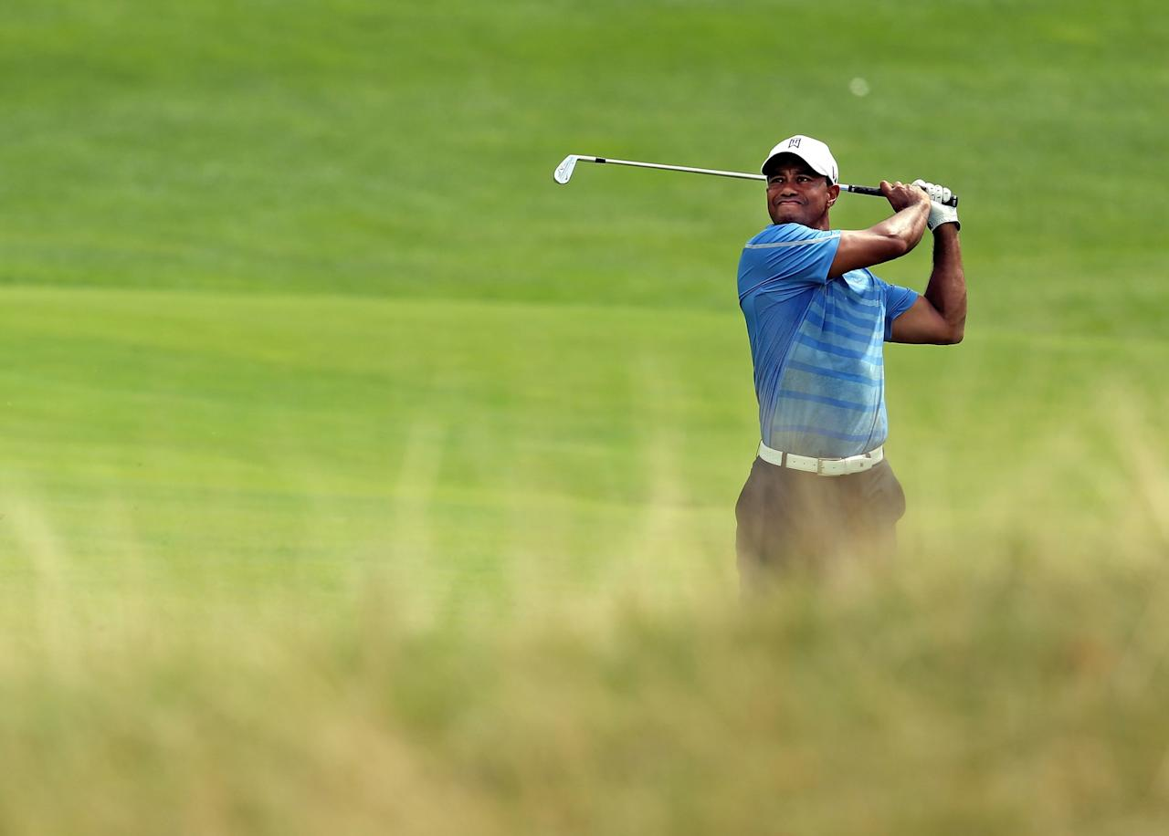 JERSEY CITY, NJ - AUGUST 22: Tiger Woods of the United States watches his second shot on the 15th hole during the first round of The Barclays at Liberty National Golf Club on August 22, 2013 in Jersey City, New Jersey. (Photo by Jeff Gross/Getty Images)