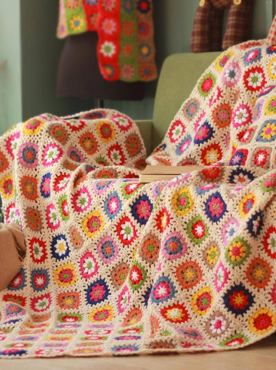 """If your grandma never taught you how to crochet a blanket yourself, support independent artisans and add this pretty one to your couch or bed. $39, Etsy. <a href=""""https://www.etsy.com/listing/884055447/granny-square-daisy-crochet-blanket"""" rel=""""nofollow noopener"""" target=""""_blank"""" data-ylk=""""slk:Get it now!"""" class=""""link rapid-noclick-resp"""">Get it now!</a>"""