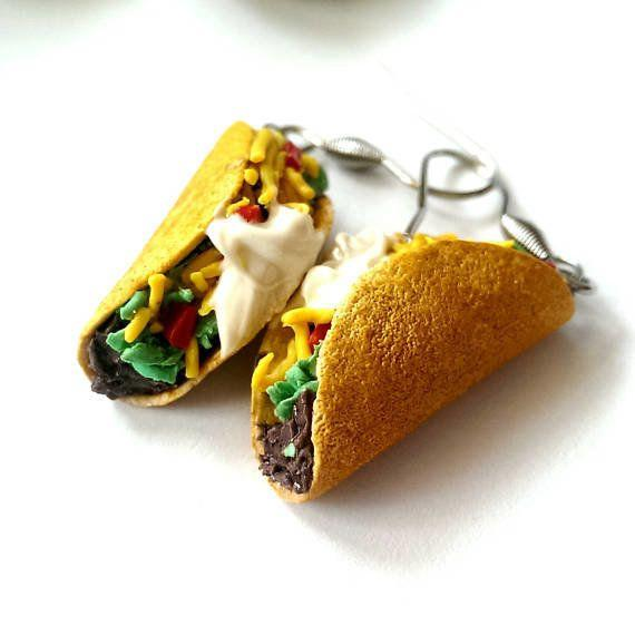 """<a href=""""https://www.etsy.com/listing/515459395/realistic-taco-earrings-food-jewelry?ga_order=most_relevant&ga_search_type=all&ga_view_type=gallery&ga_search_query=tacos&ref=sr_gallery_41"""" target=""""_blank"""">Shop it here</a>."""