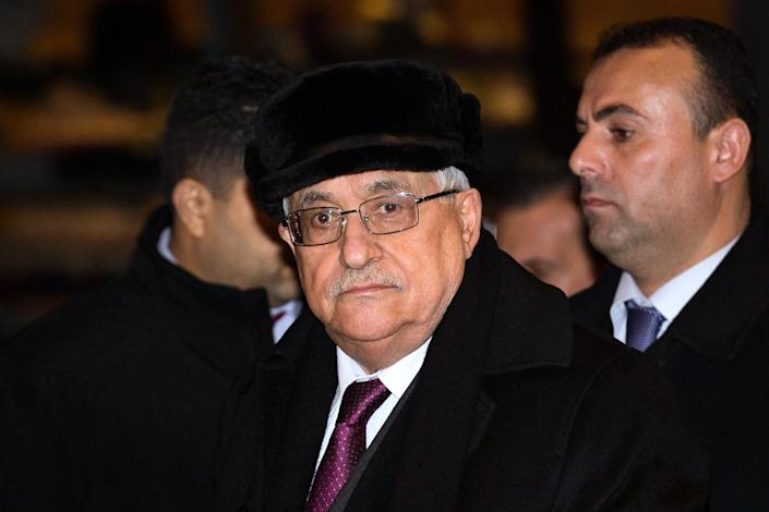 Palestinian President Mahmoud Abbas arrives at the United Nations Plaza Hotel, Tuesday, Nov. 27, 2012, in New York. The Palestinians predicted a historic U.N. vote recognizing their statehood this week, praising important new support from France on Tuesday and likely backing from other European nations seen as critical to enhancing their international standing. (AP Photo/John Minchillo)