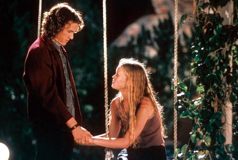 Heath Ledger and Julia Stiles at swing in a scene from the film '10 Things I Hate About You', 1999. (Photo by Buena Vista/Getty Images)