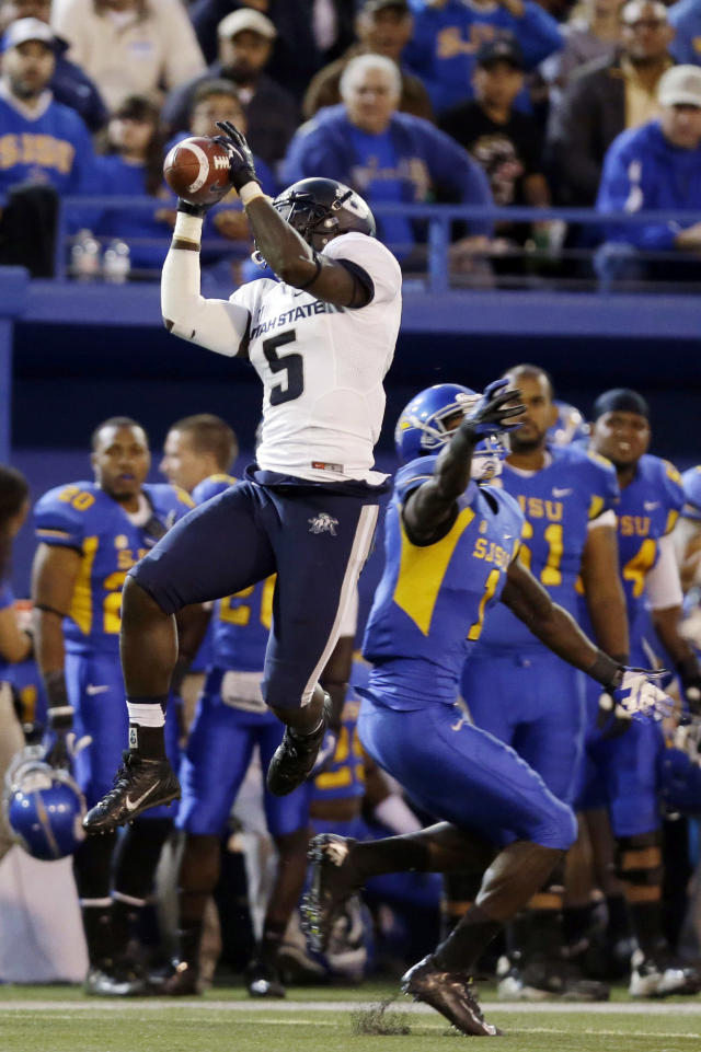Utah State safety Maurice Alexander, left, intercepts a pass intended for San Jose State wide receiver Jabari Carr during the first half of an NCAA college football game Friday, Sept. 27, 2013, in San Jose, Calif. (AP Photo/Marcio Jose Sanchez)