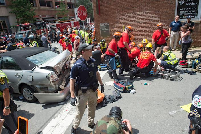 <p>A woman is received first-aid after a car accident ran into a crowd of protesters in Charlottesville, Va., on Aug. 12, 2017. (Photo: Paul J. Richards/AFP/Getty Images) </p>