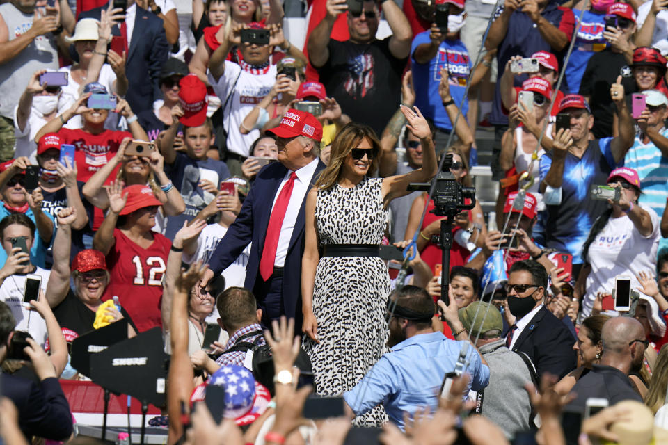 President Donald Trump and first lady Melania Trump arrive for a campaign rally Thursday, Oct. 29, 2020, in Tampa, Fla. (AP Photo/Chris O'Meara)