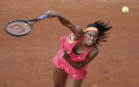 Keys of the U.S. serves the ball to Errani of Italy during their women's singles match at the French Open tennis tournament at the Roland Garros stadium in Paris