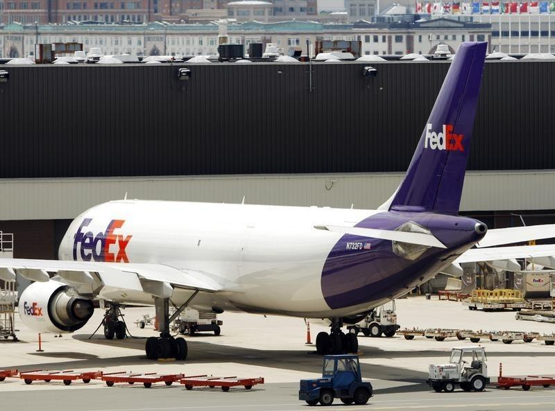 A FedEx plane sits on the tarmac at Logan International Airport in Boston