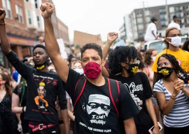 Demonstrators march in Minneapolis, Minn., on June 6, 2020, less than two weeks after Floyd's death. The bystander video of Floyd's arrest shared online caused widespread outrage and protests and led to a global reckoning over racism and police brutality.