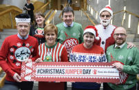 <p>Leaders of the Scottish political parties, (back row, from the left) Maree Todd, Presiding Officer Ken Macintosh, Anas Sarwar and (front row, from the left) Willie Rennie, Nicola Sturgeon, Ruth Davidson and Patrick Harvey, wear their Christmas jumpers at a photocall at the Parliament at Holyrood, Edinburgh. (PA) </p>