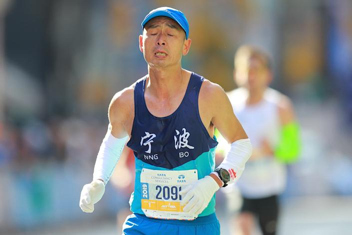 A runner tries to ignore the pain as reaches the 16th mile point of the 2019 New York City Marathon. (Photo: Gordon Donovan/Yahoo News)