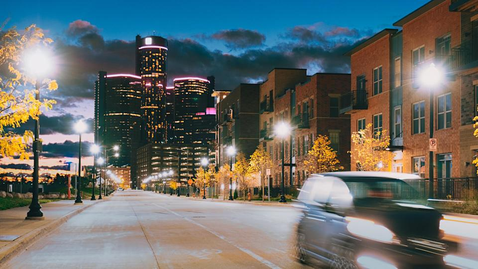 Streets of Detroit with Renaissance center at night.