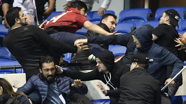 There was trouble ahead of the Europa League clash as fans sought refuge on the field after violence prior to the match