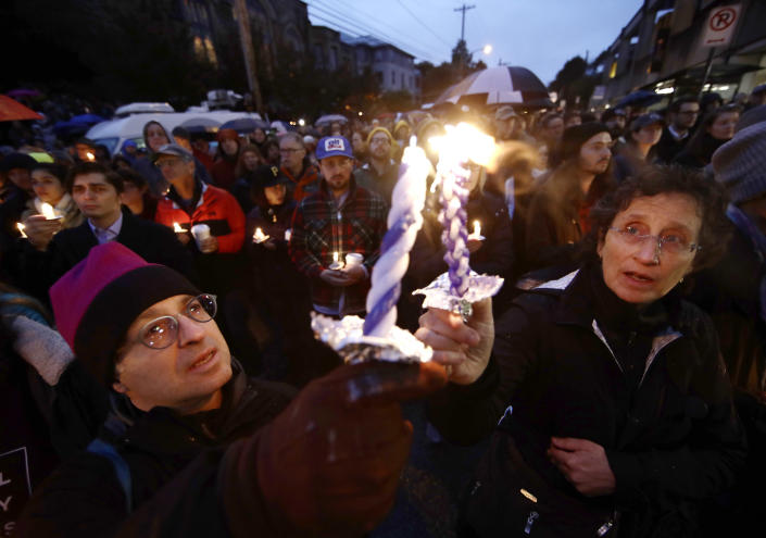 People light candles as they gather for a vigil in the aftermath of a deadly shooting at the Tree of Life synagogue in the Squirrel Hill neighborhood of Pittsburgh on Saturday. (Photo: Matt Rourke/AP)