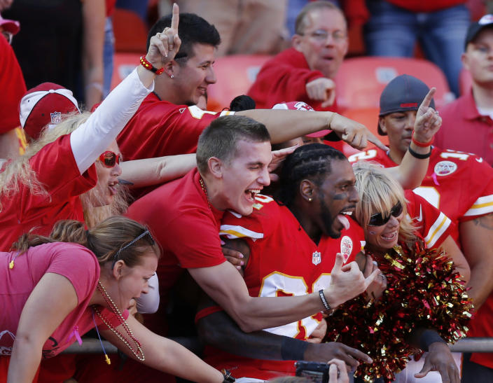 Kansas City Chiefs wide receiver Dwayne Bowe (82) celebrates with fans following an NFL football game against the Oakland Raiders at Arrowhead Stadium in Kansas City, Mo., Sunday, Oct. 13, 2013. The Chiefs defeated the Raiders 24-7. (AP Photo/Ed Zurga)