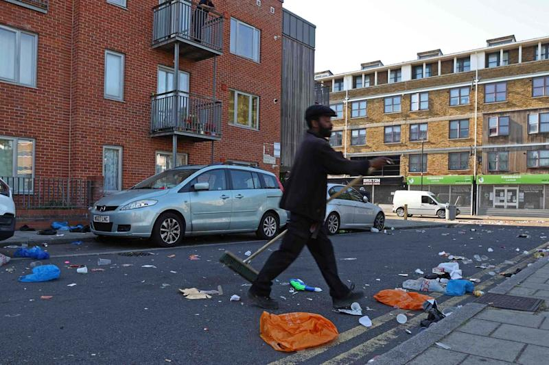 Rubbish was strewn across the street during the clashes (NIGEL HOWARD ©)