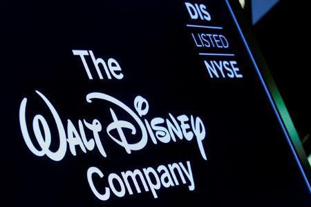 A screen shows the trading info for The Walt Disney Company company on the floor of the NYSE in New York