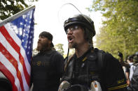Members of the Proud Boys and other right-wing demonstrators rally on Saturday, Sept. 26, 2020, in Portland, Ore. (AP Photo/Allison Dinner)
