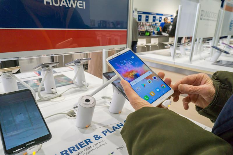A consumer tries out an Huawei brand, Chinese manufactured, smartphone in a Best Buy store in New York on Thursday, March 22, 2018. Best Buy is reported to be cutting relations with Huawei Technologies citing scrutiny of Chinese tech firms selling products in the U.S. There are allegations of spying and its close ties to the Chinese military and intellectual property theft regarding Huawei. (�Photo by Richard B. Levine)