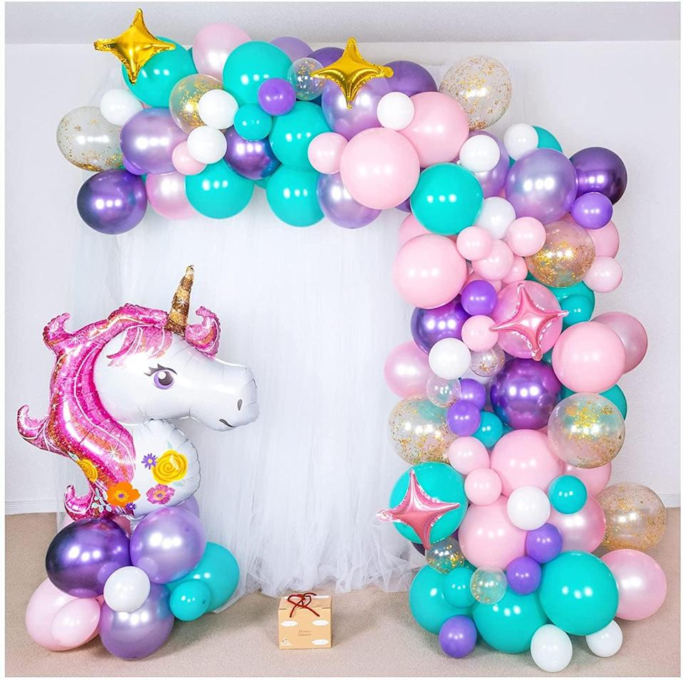 <p>If you love all things unicorns and want something truly magical, the <span>Shimmer and Confetti Premium 16-foot DIY Unicorn Balloon Arch and Garland Kit</span> ($23) is a must. It comes with a giant unicorn, stars, and confetti balloons.</p>