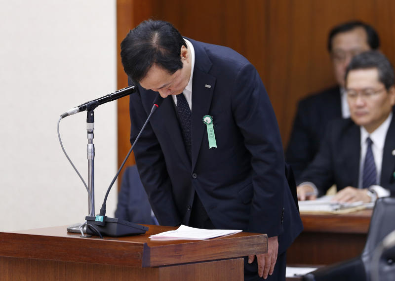 Mizuho Financial Group President Yasuhiro Sato bows at the beginning of a session as he is summoned by the Committee on Financial Affairs of the lower house of Parliament in Tokyo Wednesday, Nov. 13, 2013. Japanese banks are pledging more stringent efforts to prevent dealings with organized crime after an investigation into such lending at Mizuho prompted disclosures of wider problems. Sato forfeited six months pay, and the chairman of Mihuzo's banking business resigned. Asked if that was penalty enough, Sato acknowledged some people were calling for harsher penalties, but noted that his bank was not the only lender to have been caught extending mob-linked loans. (AP Photo/Shuji Kajiyama)