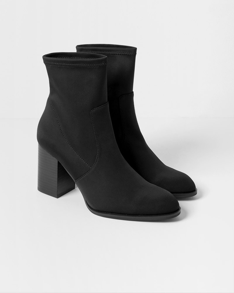"""<h3>Block Heel</h3><br>We love an elevated boot for everyday wear, and a block-heel style will help you stay on sturdy footing.<br><br><strong>Intentionally Blank</strong> Janet Scuba Boo, $, available at <a href=""""https://go.skimresources.com/?id=30283X879131&url=https%3A%2F%2Fwww.thedreslyn.com%2Fjanet-scuba-boot-1.html"""" rel=""""nofollow noopener"""" target=""""_blank"""" data-ylk=""""slk:The Dreslyn"""" class=""""link rapid-noclick-resp"""">The Dreslyn</a>"""