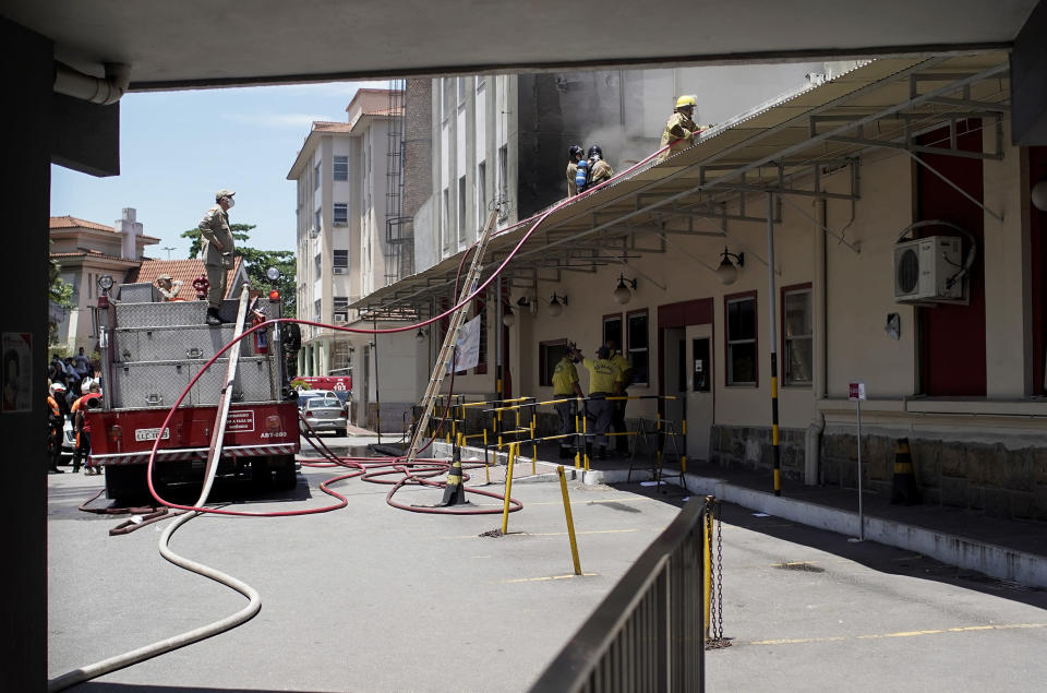 Firefighters work to douse a fire that broke out at the Bonsucesso Federal Hospital, which has a COVID-19 wing, in Rio de Janeiro, Brazil, Tuesday, Oct. 27, 2020. According to the fire department, there were no casualties. (AP Photo/Silvia Izquierdo)