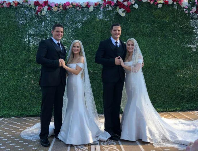 Brittany and Briana Deane and husbands Jeremy and Josh Slater on their wedding day in Ohio.