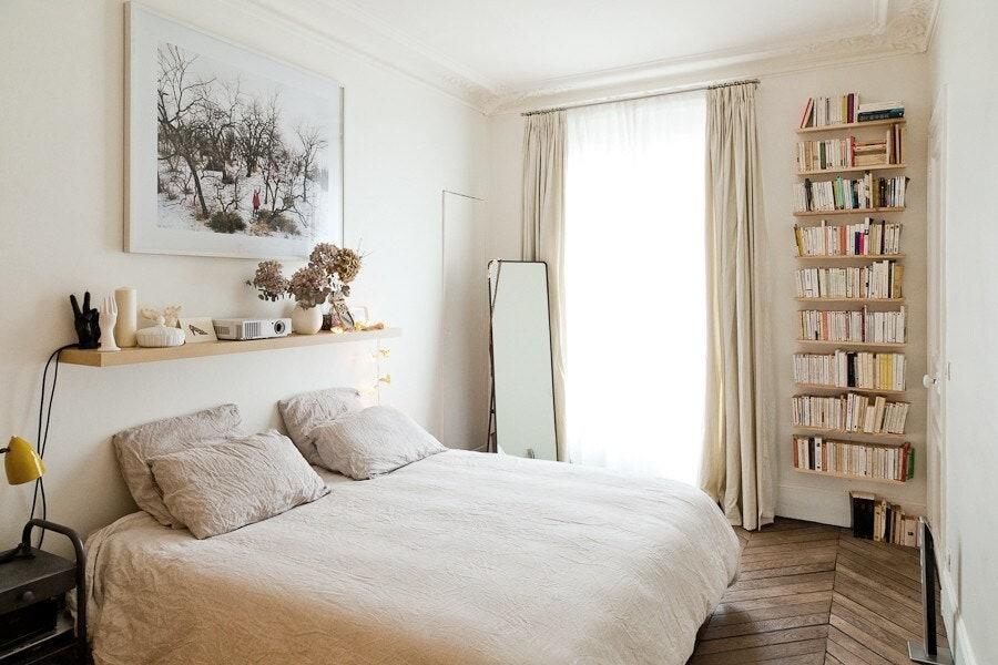"""This sweet Airbnb next to Paris's Gare du Nord <a href=""""https://www.cntraveler.com/galleries/2013-02-01/most-beautiful-train-stations-photos?mbid=synd_yahoo_rss"""" rel=""""nofollow noopener"""" target=""""_blank"""" data-ylk=""""slk:train station"""" class=""""link rapid-noclick-resp"""">train station</a> is chock-full of books, with bookcases everywhere you turn in the bedroom and sun-filled living room. Somehow, though, it feels just curated enough thanks to its relatively minimal decor. If you get tired of perusing the book selection, there's a projector for movie nights from bed (and of course, all of Paris just outside). $152, Airbnb (Starting Price). <a href=""""https://www.airbnb.com/rooms/1459306"""" rel=""""nofollow noopener"""" target=""""_blank"""" data-ylk=""""slk:Get it now!"""" class=""""link rapid-noclick-resp"""">Get it now!</a>"""