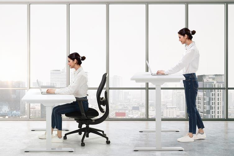 Woman using a standing desk on sale for EOFY 2021