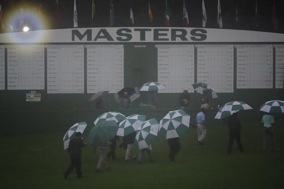 Official leave the Augusta National Golf Course after play was suspended during the first round of the Masters golf tournament Thursday, Nov. 12, 2020, in Augusta, Ga.(AP Photo/Matt Slocum)