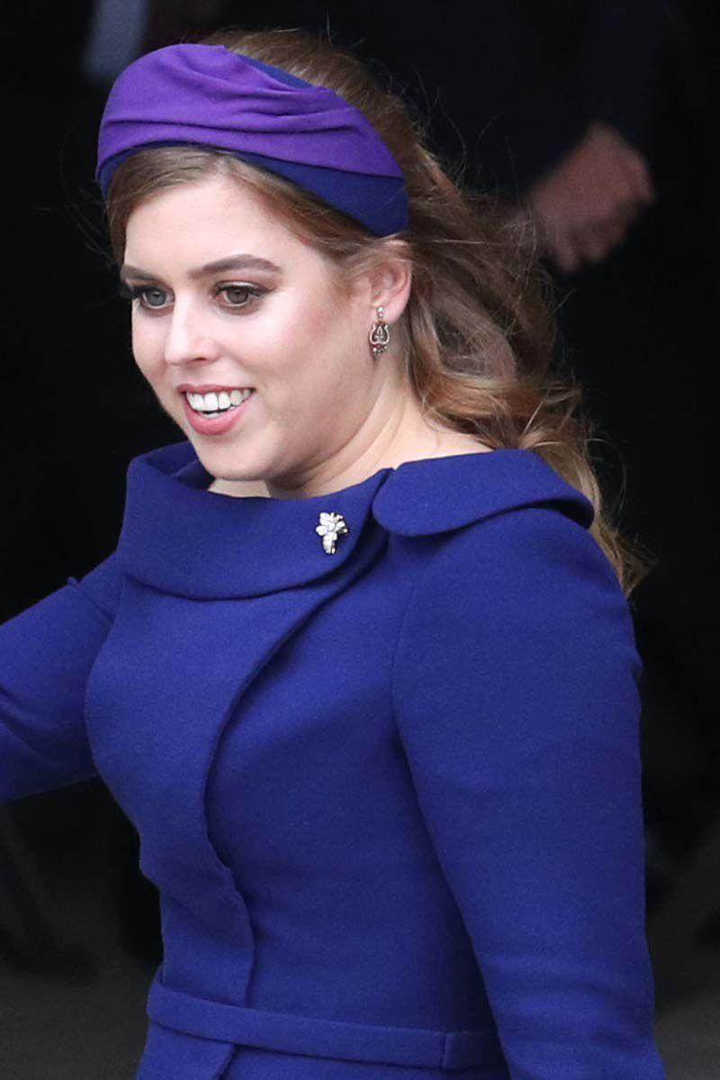 <p>For her sister Eugenie's wedding, Princess Beatrice paired her half-up half-down hairstyle with a thick cobalt blue and purple headband.</p>