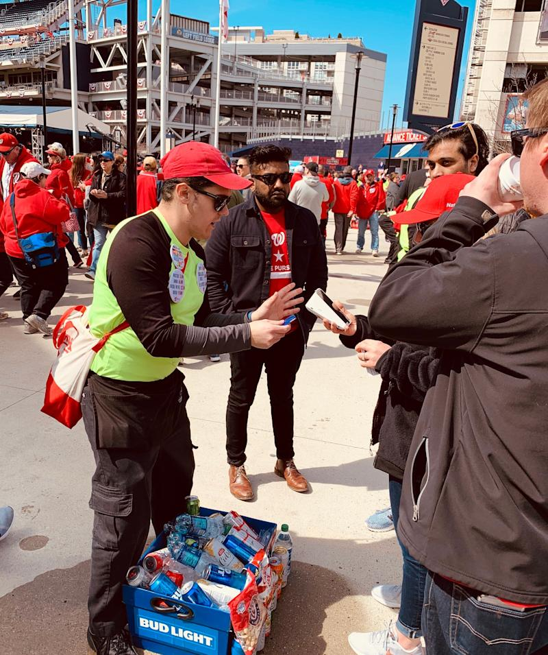 A beer seller uses Square Terminal to take payment at Nationals Park in Washington, DC. (Square)