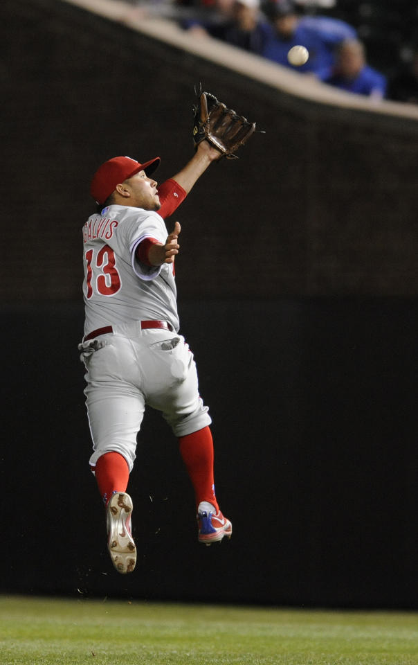 CHICAGO, IL - MAY 17:  Freddy Galvis #13 of the Philadelphia Phillies makes a leaping catch against the Chicago Cubs in the ninth inning on May 17, 2012 at Wrigley Field in Chicago, Illinois. The Philadelphia Phillies defeated the Chicago Cubs 8-7.  (Photo by David Banks/Getty Images)